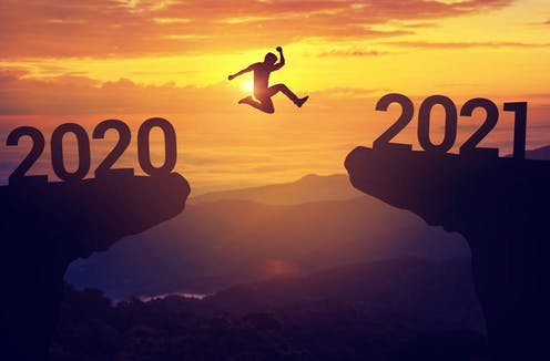 Person jumps from symbolic '2020' cliff to '2021' cliff.