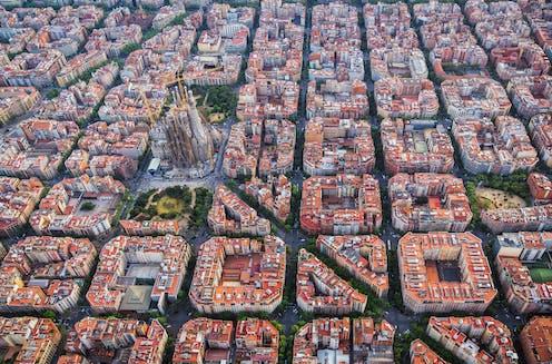 Aerial view of regular city blocks and basilica.