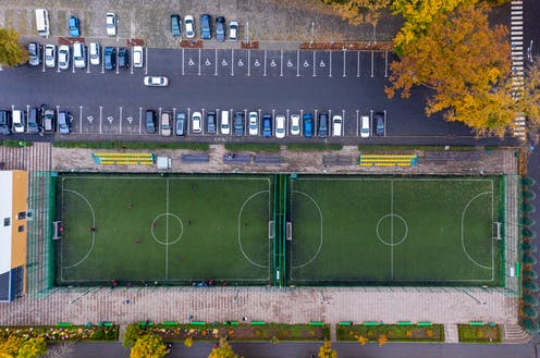 A car park and sports field
