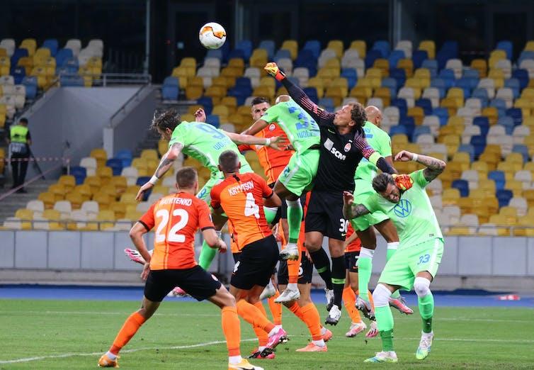 VfL Wolfsburg (in green) during a match