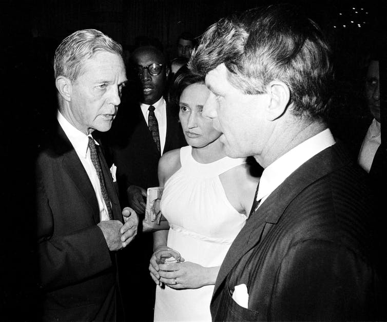 A 1967 photo shows U.S. Sen. Joseph Clark of Pennsylvania talking with fellow Sen. Robert Kennedy of New York.