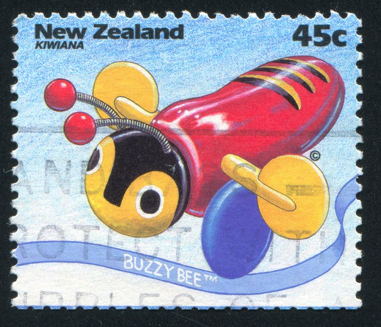 Postage stamp with image of buzzy bee toy