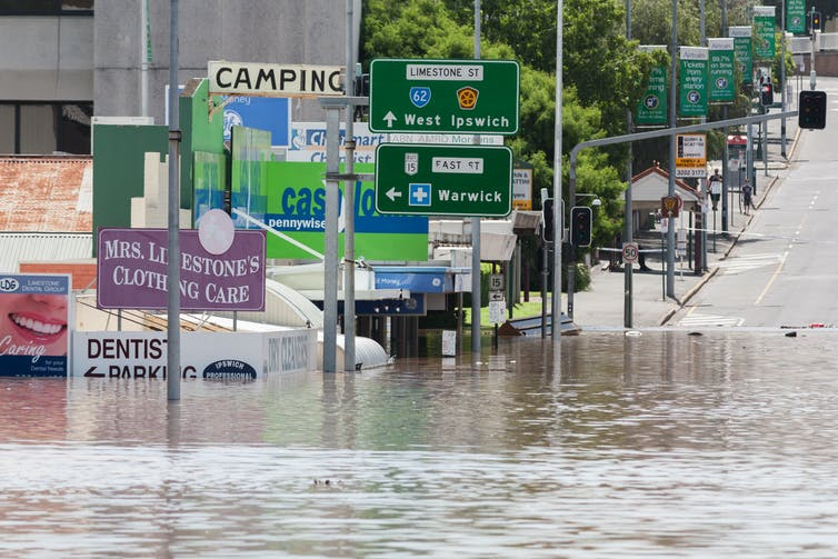 Floodwaters engulf the streets of Ipswich.