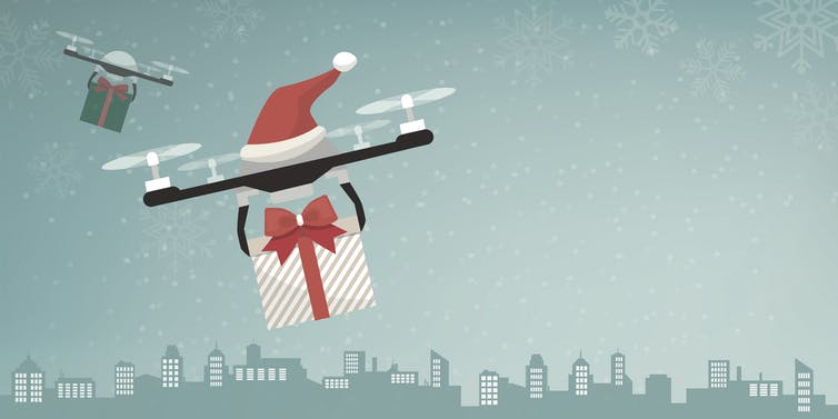 Illustration of two drones carrying gifts and decorated with Santa hats.