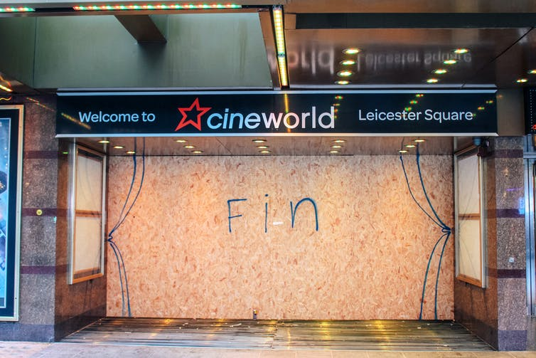 Cineworld cinema boarded up with Fin written over the shopfront in graffiti