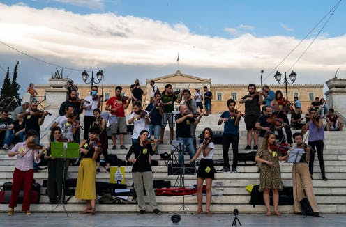 A group of Greek musicians staging a musical protest outside the Greek parliament in Athens.