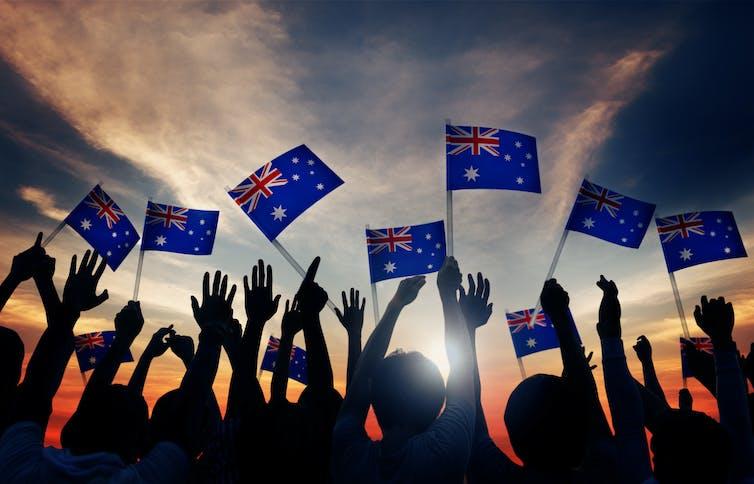 Crowd waving Australia flag
