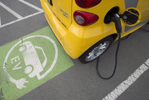 A yellow electric vehicle being charged