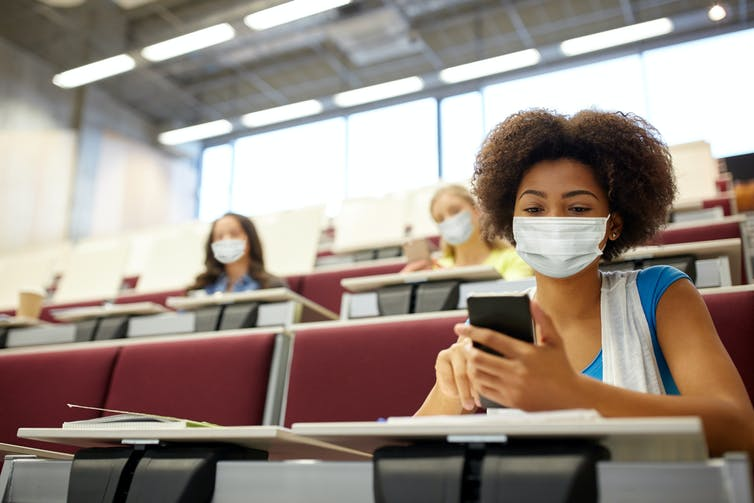 Students earing masks in a lecture theatre at university