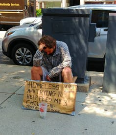 panhandler with sign