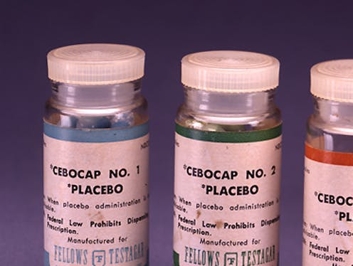 Three bottles containing placebos.