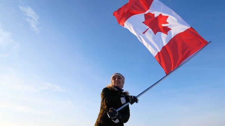 Woman waving Canadian flag