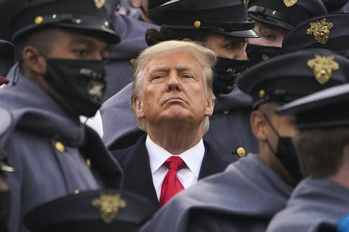 Trump surrounded by army cadets