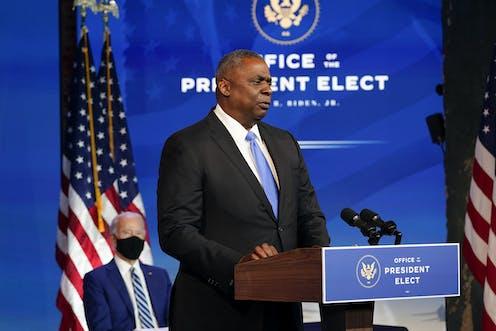 Retired Gen. Lloyd Austin speaks as President-elect Joe Biden looks on