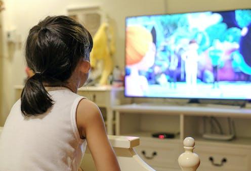 A child watching cartoons on tv