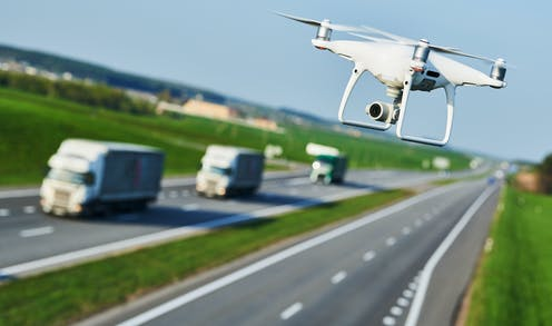 A drone flying above a road.