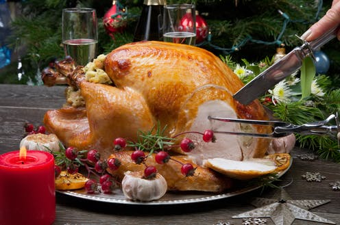 A Christmas turkey being carved.