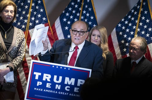 Rudy Giuliani speaks at a news conference.