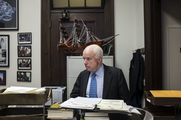 Sen. John McCain at his desk in the Senate.