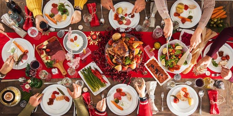 Table full of Christmas food.