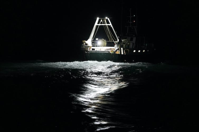 A fishing boat at night.