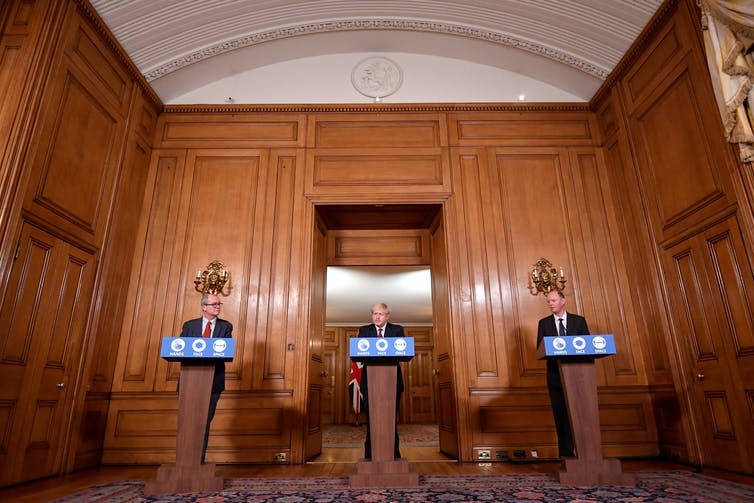 Chief scientific adviser Sir Patrick Vallance (left) and Chief Medical Officer Professor Chris Whitty (right), with Prime Minister Boris Johnson during a news conference.