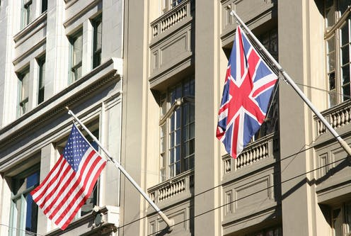 A US and UK flag on the side of a building