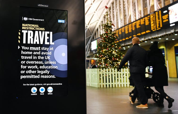 A sign displaying Tier 4 rules at King's Cross station in London