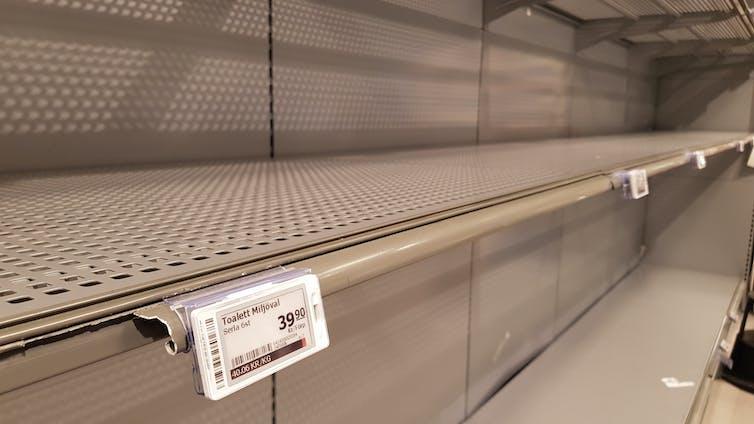 Sweden, Stockholm : 2020, March 17 : The empty shelf of toilet paper in the supermarket in Stockholm, Sweden.