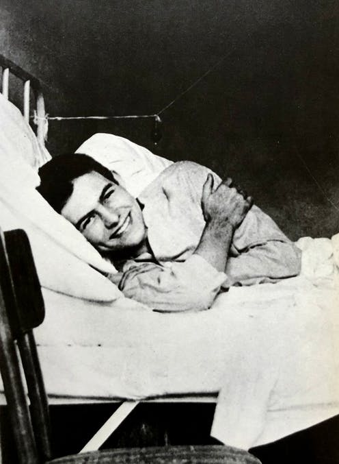 A smiling man in hospital bed.