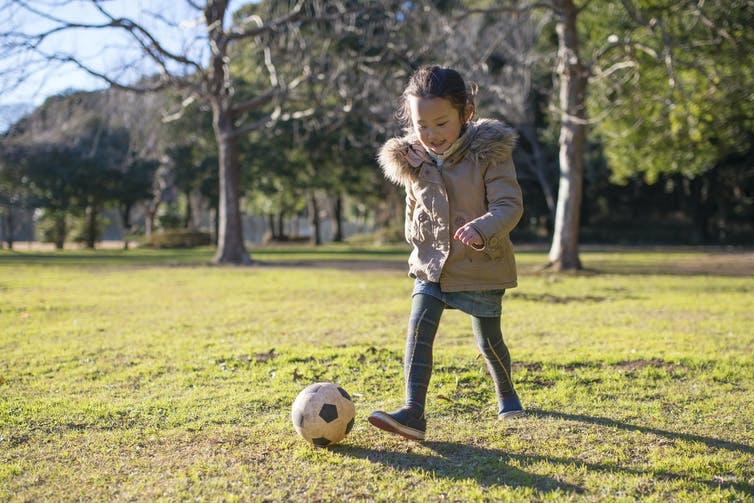 Girl with soccer ball.