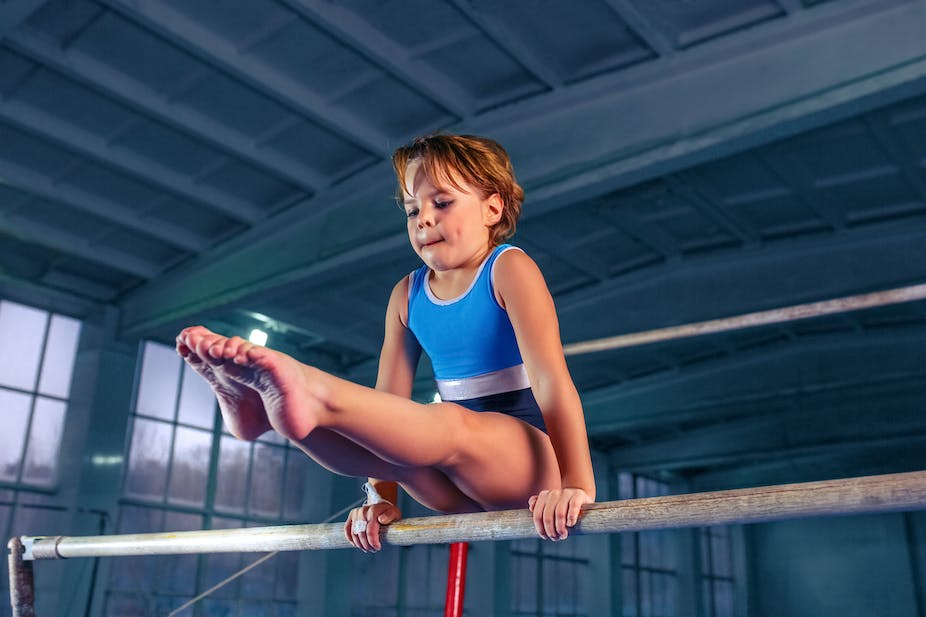 A young girl practicing her gymnastics.