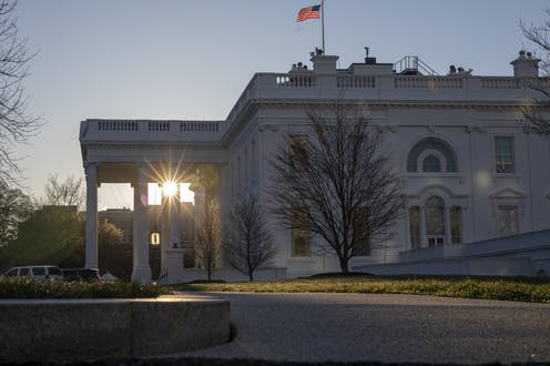 sunrise seen through the White House portico