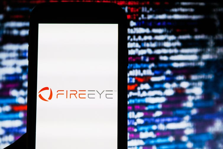 A smart phone displaying the FireEye logo
