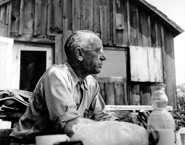 Aldo Leopold seated outdoors