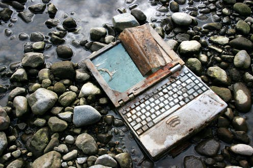 Discarded laptop on the ground