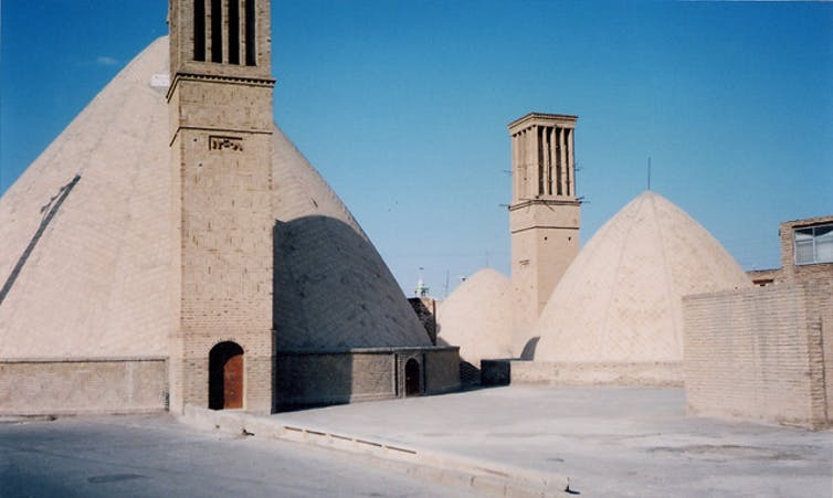 Large double-domed stone structures with windcatcher towers.