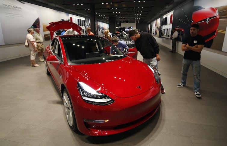 People in a Tesla showroom