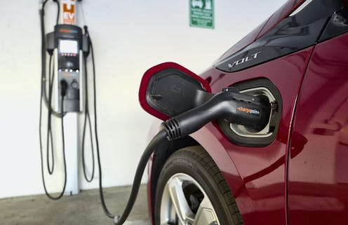 Electric vehicle being recharged