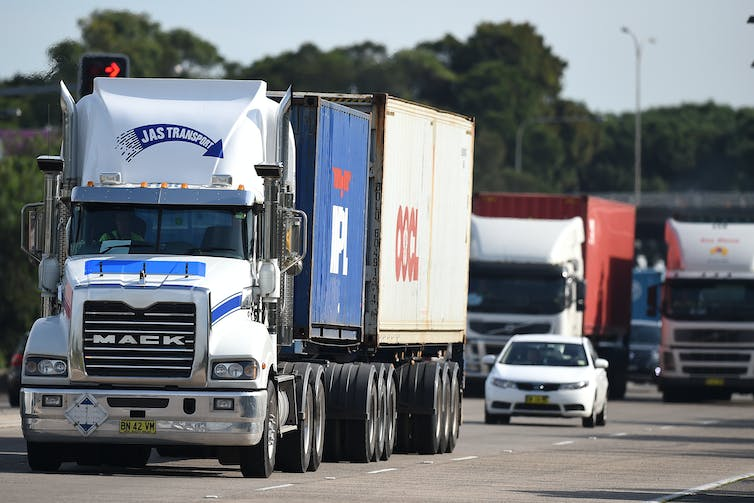 Trucks bunched up on multilane highway