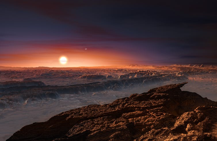 Sun rises over rocky alien landscape.