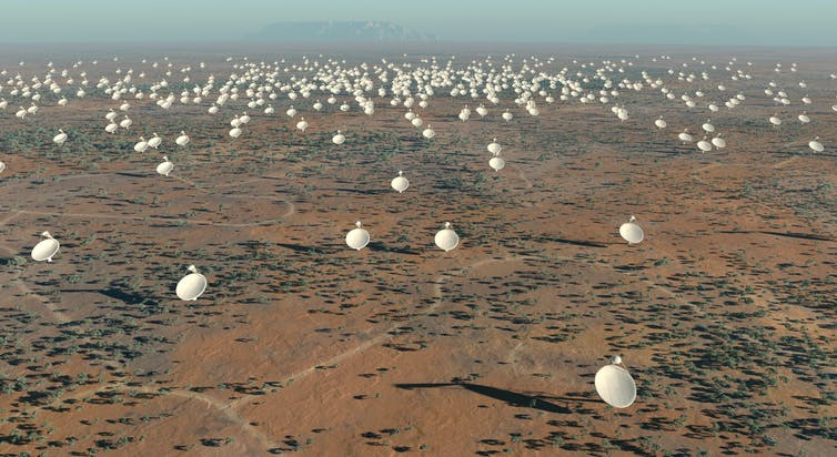 SETI: new signal excites alien hunters. Hundreds of large satellite dishes in a desert.