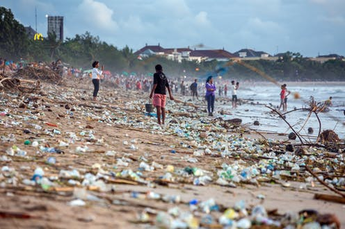 Plastic bottles strewn over a beach in Bali in 2017