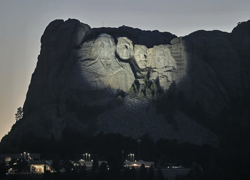 Carving of former US presidents in the side of Mount Rushmore.