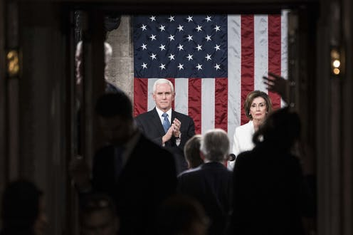Pence and Pelosi in front of an American flag