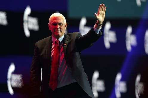 Vice President Mike Pence waves after speaking during the Turning Point USA Student Action Summit, Tuesday, Dec. 22.