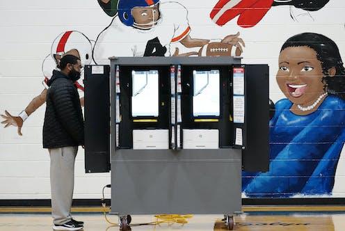 A voter casts a ballot