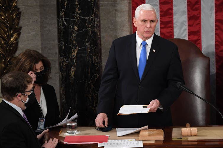 Vice President Mike Pence presides over the joint session of Congress reviewing Electoral College votes on Jan. 6, 2021.