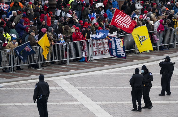 Gadsden flags fly at a Jan. 6, 2021, protest at the Capitol.