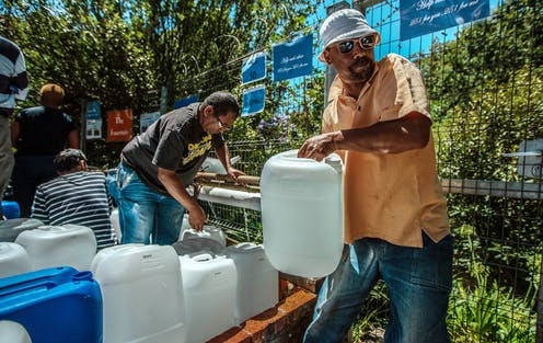 People fill water containers in Cape Town during the drought.